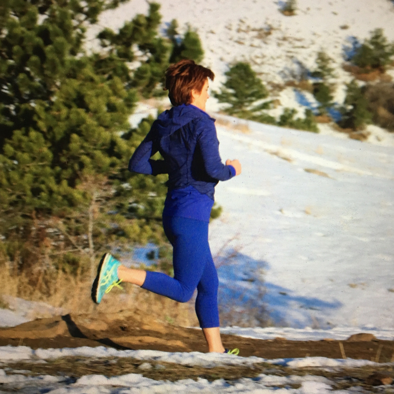 midlife woman running in mountains