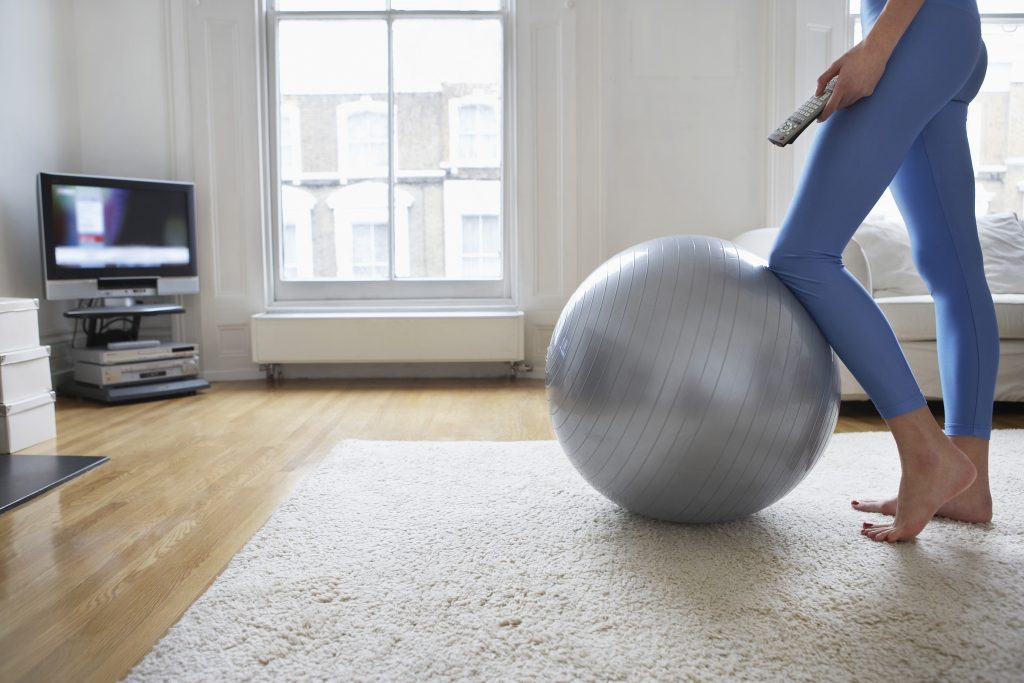Woman Exercising with Television