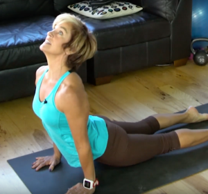 woman upward facing dog pose